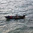 Fishermen with rod fishing from the boat — Stock Photo #5637958