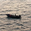 Fishermen with rod fishing from the boat — Stock Photo