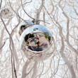 Christmas tree balls and mirroring of father and sun with fun - Stock Photo