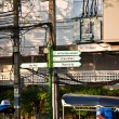 Signs for tourists to show way to main attractions of Bangkok — Stock Photo #5639455