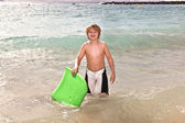 Boy has fun at the beach — Stock Photo