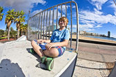 Cute boy sitting at the skate park — Stock Photo