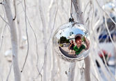 Christmas tree balls and mirroring of father and sun with fun — Stock Photo