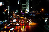 Cars by night on a main road in Bangkok with lights on — Stock Photo