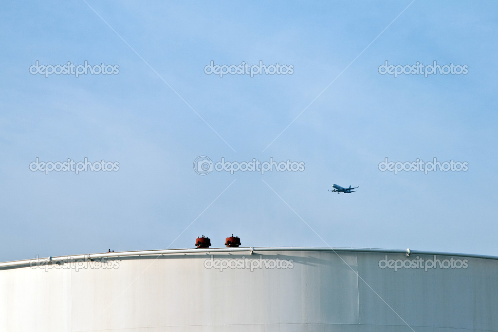 Aircraft over white tank farm — Stock Photo #5640354