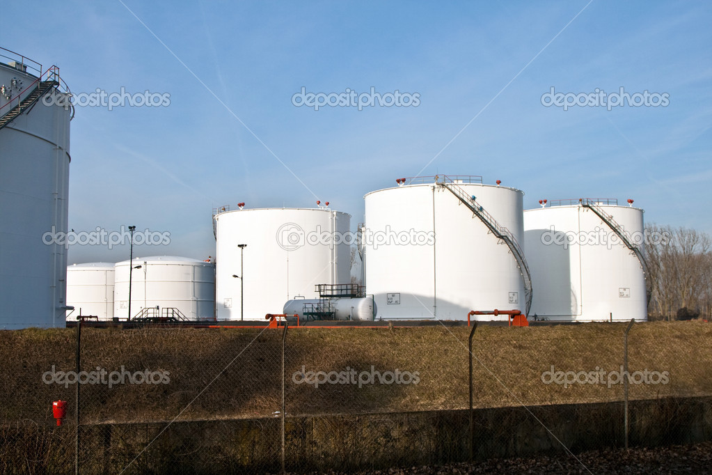 White tanks in tank farm with blue sky — Stock Photo #5640433