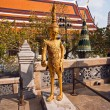 Royalty-Free Stock Photo: Famous temple Phra Sri Ratana Chedi covered with foil gold in the inner Gra