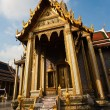 Stock Photo: Famous temple PhrSri RatanChedi covered with foil gold in inner Gra