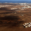 Aerial of Lanzarote with wind power plant - Stock Photo