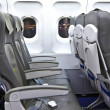 Empty seats in the aircraft - Stock Photo