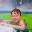 Children having fun in the outdoor thermal pool - Stock Photo