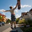 Boy is jumping and doing tricks with the scateboard on the side — Stock Photo