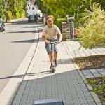 Boy has fun scating on a paveway — Stock Photo