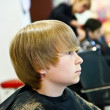 Young boy  at the hairdresser - Stock Photo