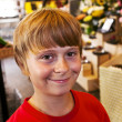 Young boy smiles in a shop — Stock Photo #5656762