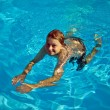 Child swims in the pool — Stock Photo #5656788