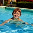 Child has fun in the pool — Stock Photo #5656827