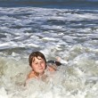 Child has fun in the waves — Stock Photo #5656889