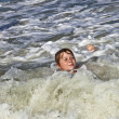 Child has fun in the waves — Stock Photo #5656890