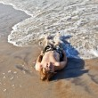 Boy lying at the beach and enjoying the ocean — Stock Photo #5656902