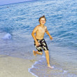 Boy is jogging at the beautiful beach — Stock Photo #5656970