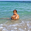 Boy enjoys the clear water in the ocean — Stock Photo #5656978