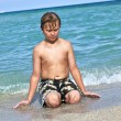 Boy enjoys the clear water in the ocean — Stock Photo #5656989