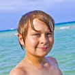Boy enjoys the clear water in the ocean — Stock Photo #5657001