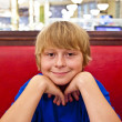 Smiling boy in a diners at night — Stok fotoğraf