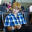 Stock Photo: Boy is waiting for departure at airport