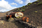 Old tank in volcanic landscape — Stock Photo