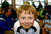 Young boy in soccer arena smiles — Stock Photo