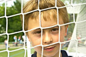 Young boy plays soccer and enjoys it — Stock Photo