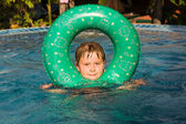 Boy swims with a ring in the pool — Stock Photo