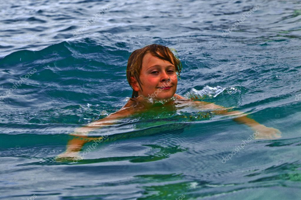 boy is swimming in the ocean � stock photo 169 hackman 5657030
