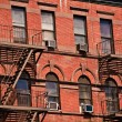 fire ladder at old houses downtown in new york — Stock Photo