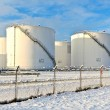 White tanks in tank farm with snow in winter — Stock Photo #5663409