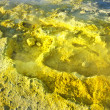 Yellow sulphur at the volcano on the island volcano in Italy - Stock Photo