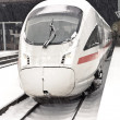High speed train in station in Wintertime - Stock Photo