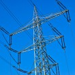 Electricity tower with power lines against a blue sky — Stock Photo #5666592