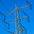 Electricity tower with power lines against a blue sky — Stock Photo