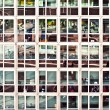 Reflection of streetlife in office building - Stock Photo