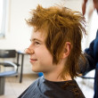 Smiling young boy with red hair at the hairdresser — Stock Photo #5666884