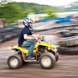 Boy enjoys Quad driving - Stock Photo