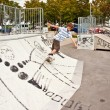 Boy skating at the skate park and has fun - Photo