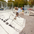 Boy skating at the skate park and has fun - Stockfoto