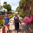 Mother with sons on the way to the beach with beach equipment — Stock Photo