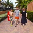 Stock Photo: Mother with two sons on way to beach