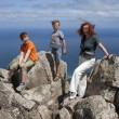 Family on top of mountain — Stock Photo
