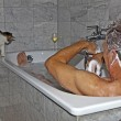 Man bathing and cat strolling around the bath tube — Stock Photo #5668957